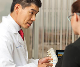Dr. Bae Teaching Patient About Spine